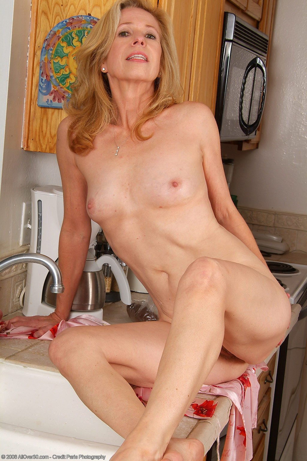 Beautiful small titted milf fucked