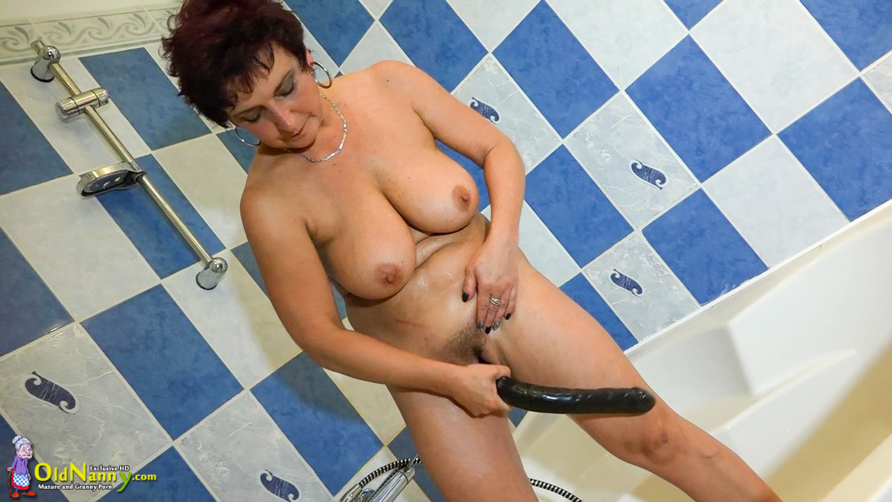 Horny mature dildo play