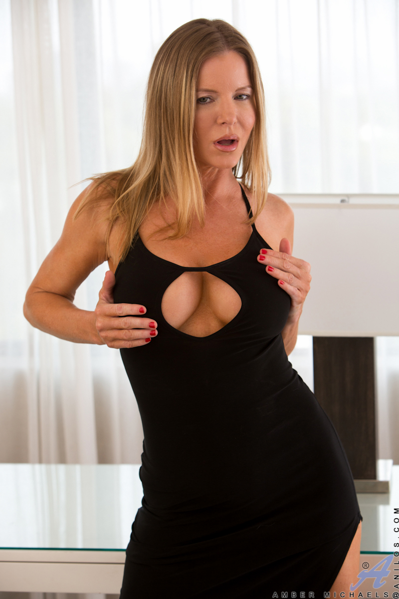 Wild milf with giant knockers amber michaels is playing