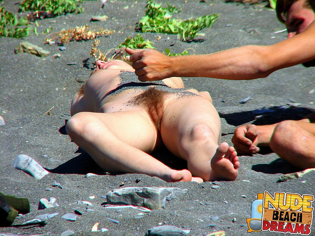 milf masturbating on the black sand