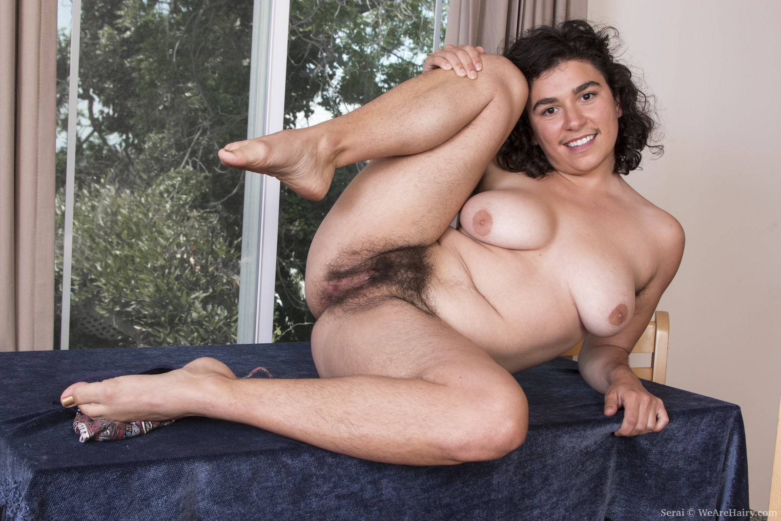 Amusing hairy pussy sitting on chair
